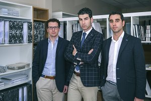 Three businessmen looking at camera in office