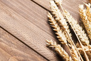 Wheat flower on wooden table.