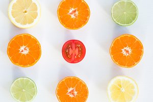 Top view of eight slices of citrus fruits