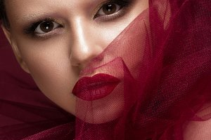 Beautiful girl with art creative make-up in image of red bride for Halloween. Beauty face.