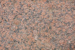 red granite wall as a texture background