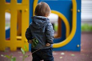 Little boy with blue eyes on a winter walk.