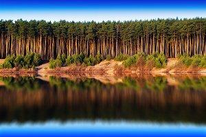 Horizontal vivid river forest reflections landscape background b