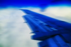 Horizontal vivid blue travel plane jet wing abstraction transpor