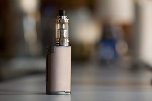 vape, electronic cigarette. blurred background.
