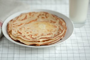 Thin crepes or pancakes with butter and milk.