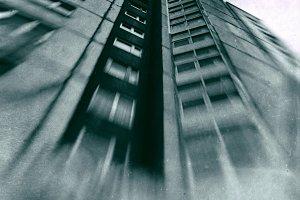 Greenish industrial skyscraper film scan