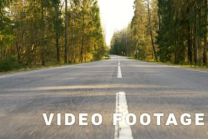 Road between forest - flying camera shot