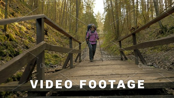 Tourist woman with backpack enjoying view to rainforest - flying camera shot
