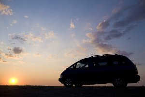 Silhouette of a car on a sunset sunset background