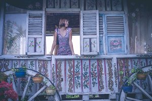 Fashion art style beauty romantic portrait of young pretty beautiful woman posing in the wooden window. Bali island, Indonesia.