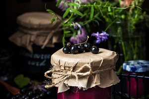 Jar of black currant curd