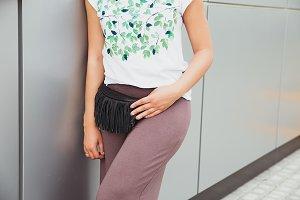 Woman in purple trousers