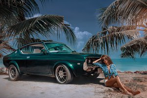 Young attractive model is sitting near retro car