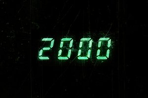 Horizontal green digital 2000 millenium display clock dust parti