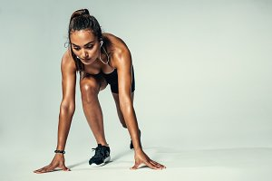 Female athlete in starting position