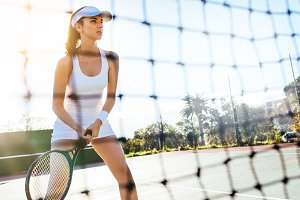 Beautiful tennis player with racket