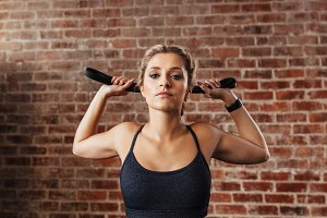 Young woman doing neck exercises