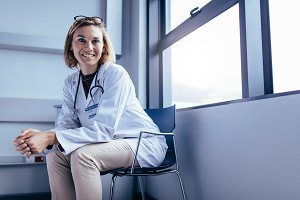Smiling female doctor sitting