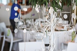 Wedding floral decorations hanging from decorative tree