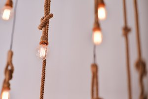 Electric lamps hanging on a rope