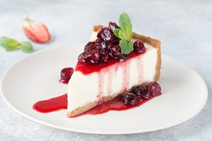 Slice of cheesecake with berry sauce