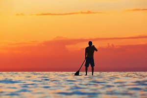 Sunset paddle boarder