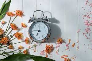 Vintage alarm clock and flowers