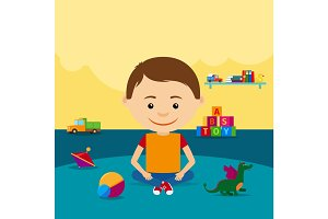 Boy sitting on floor with toys