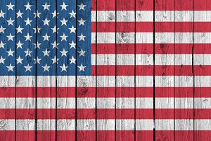 American flag on old wood background
