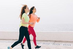 Two slim girls in sportswear