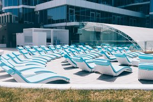 Empty blue sunbeds