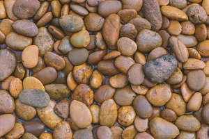 Wet stones dark pebbles