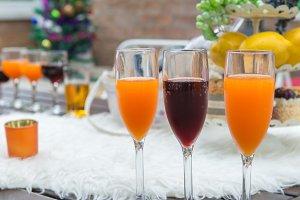 Glasses of wines and orange juice