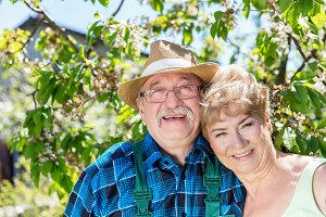Mature couple embracing time together in the garden.