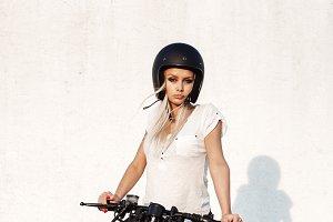 fashion female biker girl with vintage custom motorcycle