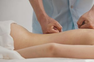 Young model woman model receiving massage at spa - healthcare concept