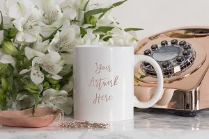 White mug mockup with rose gold