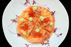 Salmon fillet and roe on Indian roti
