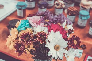 Bunch of flowers with retro filter effect. Bali handmade market, Indonesia.