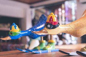 Hancrafted and hand painted funny wooden duck in souvenir shop on a tropical island of Bali, Indonesia.