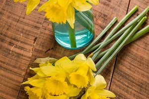 Yellow dafodills on wooden table