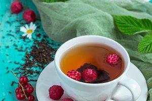 Tea with summer berries, selective focus