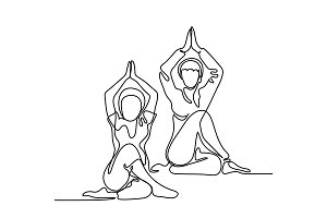 Two women doing exercise in yoga pose