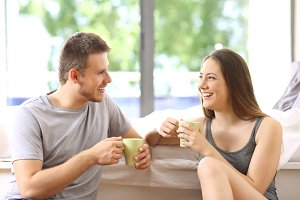 Couple talking and having breakfast