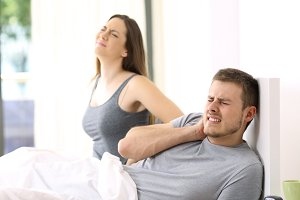 Couple waking up suffering ache