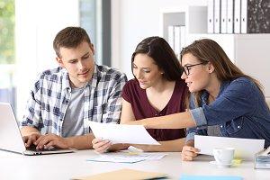 Entrepreneurs analyzing reports