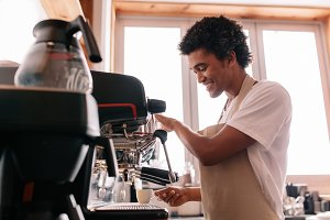 Young man making coffee