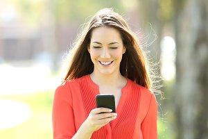 Women walking using smart phone