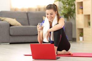 Fitness women watching tutorials